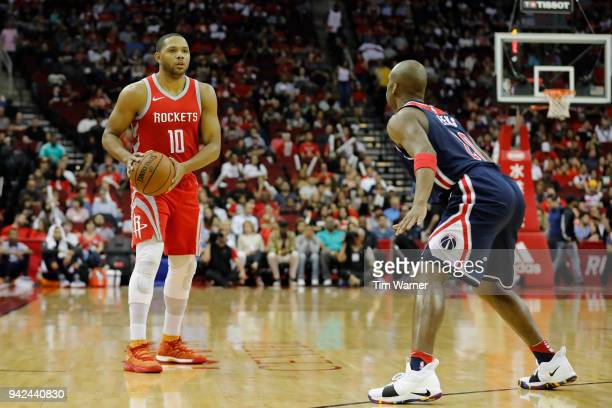 Eric Gordon of the Houston Rockets controls the ball defended by Jodie Meeks of the Washington Wizards in the first half at Toyota Center on April 3...