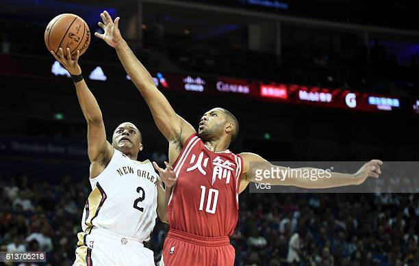 Eric Gordon of the Houston Rockets defends against Tim Frazier of the New Orleans Pelicans during the preseason game as part of the 2016 Global Games...