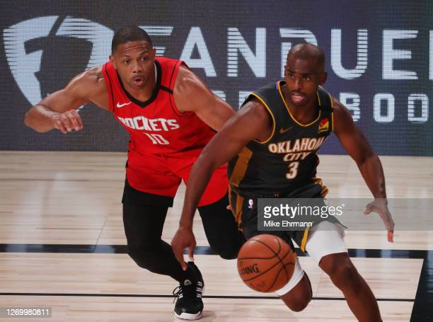 Eric Gordon of the Houston Rockets defends as Chris Paul of the Oklahoma City Thunder drives the ball during the third quarter in Game Six of the...