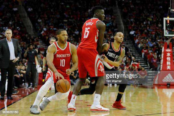 Eric Gordon of the Houston Rockets dribbles around Clint Capela defended by Shabazz Napier of the Portland Trail Blazers in the second half at Toyota...