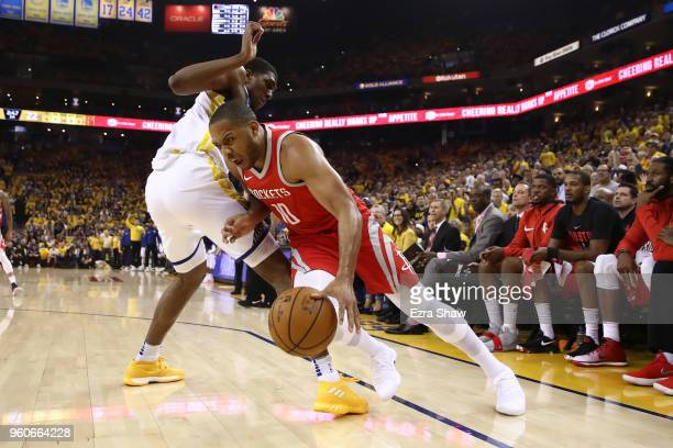 Eric Gordon of the Houston Rockets drives against Kevon Looney of the Golden State Warriors during Game Three of the Western Conference Finals of the...