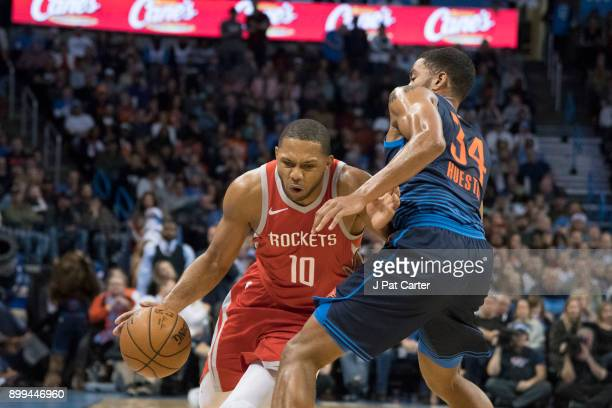 Eric Gordon of the Houston Rockets drives around Josh Huestis of the Oklahoma City Thunder during the second half of a NBA game at the Chesapeake...