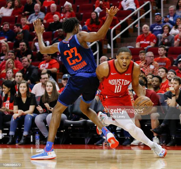 Eric Gordon of the Houston Rockets drives around Terrance Ferguson of the Oklahoma City Thunder during the first quarter at Toyota Center on December...