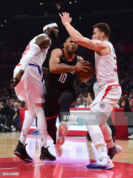 Eric Gordon of the Houston Rockets drives between Willie Reed and Blake Griffin of the LA Clippers during the first half at Staples Center on January...