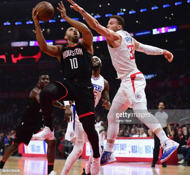 Eric Gordon of the Houston Rockets drives on Blake Griffin of the LA Clippers during the first half at Staples Center on January 15 2018 in Los...