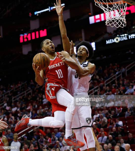 Eric Gordon of the Houston Rockets drives past Jarrett Allen of the Brooklyn Nets at Toyota Center on January 16, 2019 in Houston, Texas. NOTE TO...