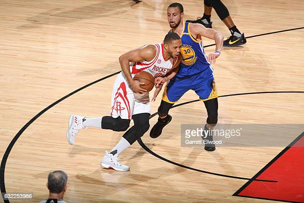 Eric Gordon of the Houston Rockets drives to the basket against Stephen Curry of the Golden State Warriors during the game on January 20 2017 at the...