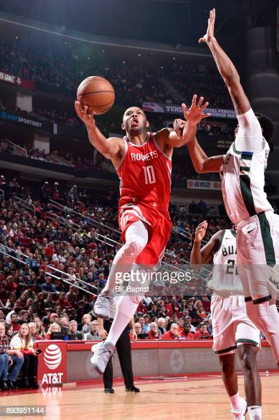 Eric Gordon of the Houston Rockets drives to the basket against the Milwaukee Bucks on December 16 2017 at the Toyota Center in Houston Texas NOTE TO...