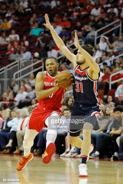 Eric Gordon of the Houston Rockets drives to the basket against Tomas Satoransky of the Washington Wizards in the first half at Toyota Center on...