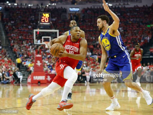 Eric Gordon of the Houston Rockets drives to the basket defended by Klay Thompson of the Golden State Warriors in the first half during Game Three of...