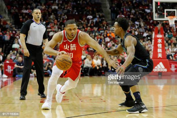 Eric Gordon of the Houston Rockets drives to the basket defended by Yogi Ferrell of the Dallas Mavericks in the first half at Toyota Center on...