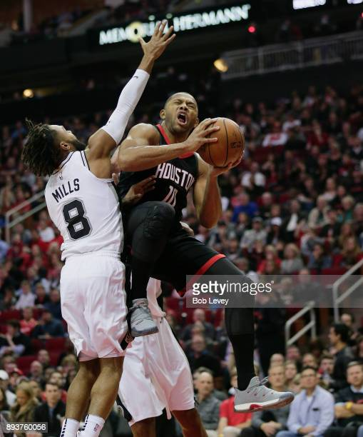 Eric Gordon of the Houston Rockets drives to the basket on Patty Mills of the San Antonio Spurs in the fourth quarter at Toyota Center on December 15...