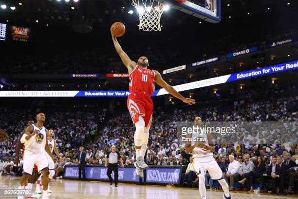 Eric Gordon of the Houston Rockets dunks the ball against the Golden State Warriors during their NBA game at ORACLE Arena on October 17 2017 in...