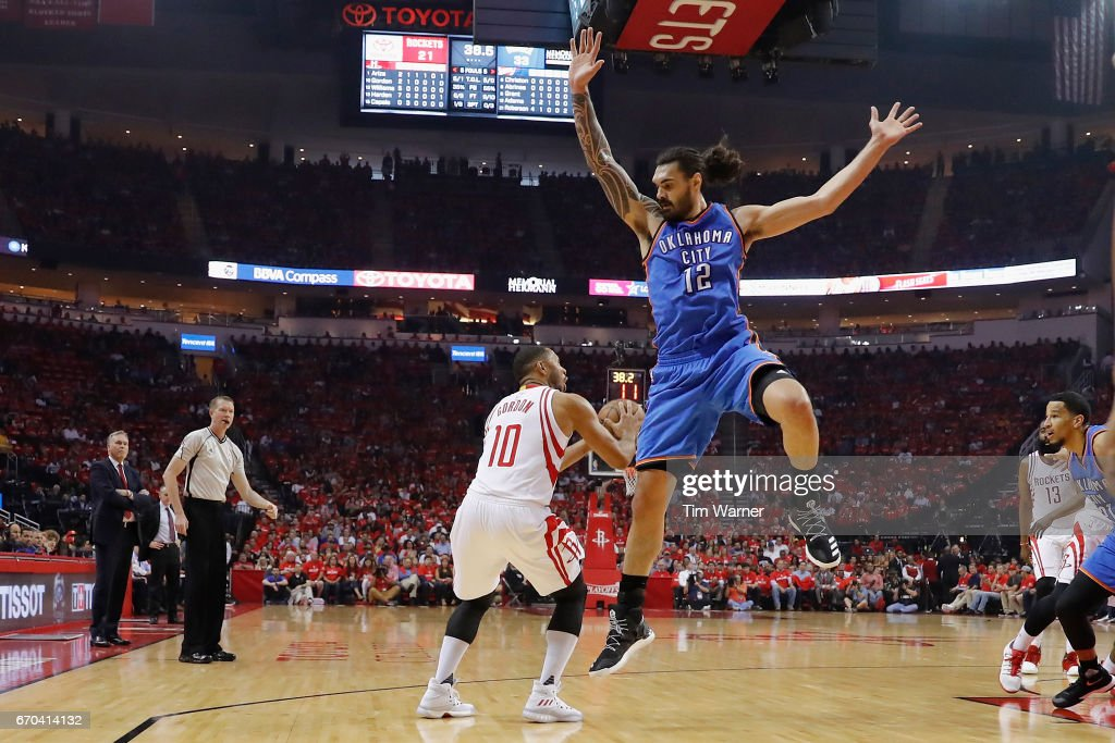 Eric Gordon #10 of the Houston Rockets gets past Steven Adams #12 of the Oklahoma City Thunder for a shot in the first half of Game Two of the Western Conference quarterfinals game during the 2017 NBA Playoffs at Toyota Center on April 19, 2017 in Houston, Texas.