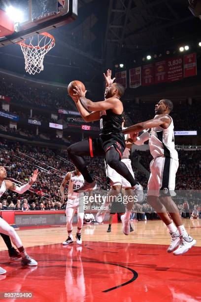 Eric Gordon of the Houston Rockets goes for a lay up against the San Antonio Spurs on December 15 2017 at the Toyota Center in Houston Texas NOTE TO...