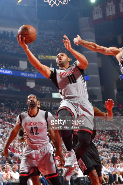Eric Gordon of the Houston Rockets goes for a lay up during the game against the San Antonio Spurs during Game Four of the Western Conference...