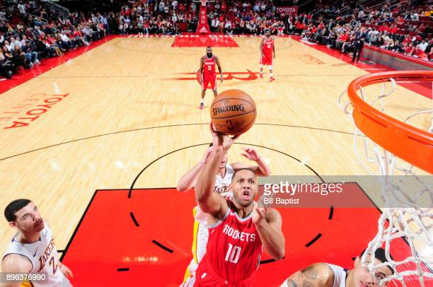 Eric Gordon of the Houston Rockets goes to the basket against the Los Angeles Lakers on December 20 2017 at the Toyota Center in Houston Texas NOTE...