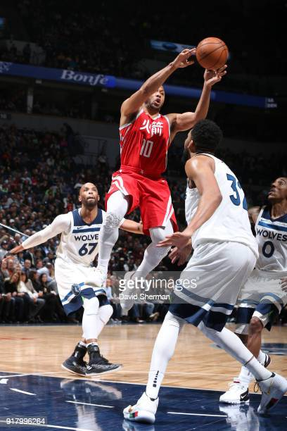 Eric Gordon of the Houston Rockets goes to the basket against the Minnesota Timberwolves on February 13 2018 at Target Center in Minneapolis...