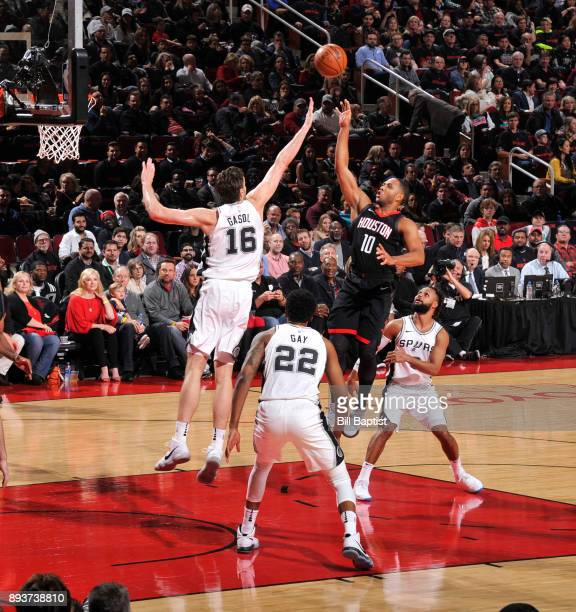 Eric Gordon of the Houston Rockets goes to the basket against the San Antonio Spurs on December 15 2017 at the Toyota Center in Houston Texas NOTE TO...