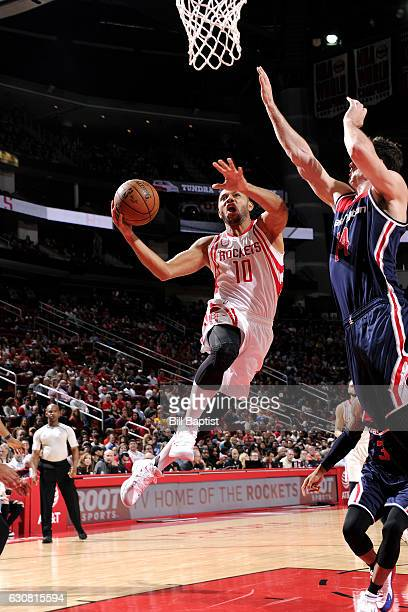 Eric Gordon of the Houston Rockets goes to the basket during the game against the Washington Wizards on January 2 2017 at the Toyota Center in...