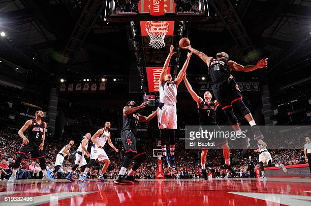 Eric Gordon of the Houston Rockets goes up for a rebound against Dwight Powell of the Dallas Mavericks during a game on October 30 2016 at the Toyota...