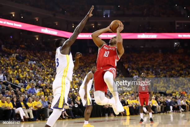 Eric Gordon of the Houston Rockets goes up for a shot against Draymond Green of the Golden State Warriors during Game Three of the Western Conference...