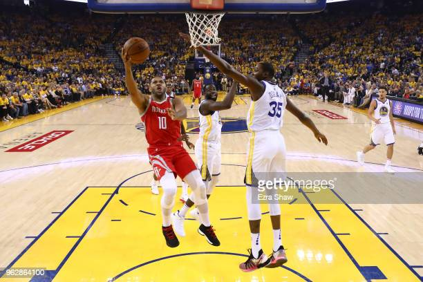 Eric Gordon of the Houston Rockets goes up for a shot against the Golden State Warriors during Game Six of the Western Conference Finals in the 2018...