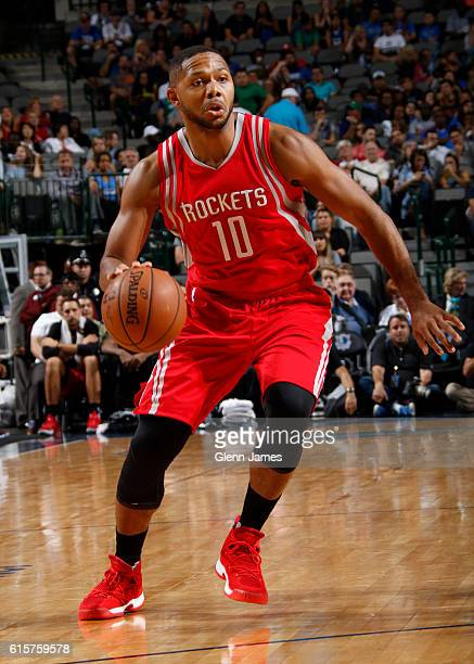 Eric Gordon of the Houston Rockets handles the ball against the Dallas Mavericks during a preseason game on October 19 2016 at the American Airlines...