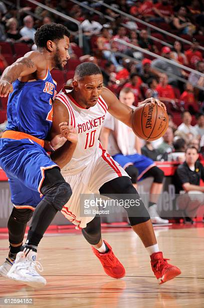Eric Gordon of the Houston Rockets handles the ball against the New York Knicks during a preseason game on October 4 2016 at the Toyota Center in...