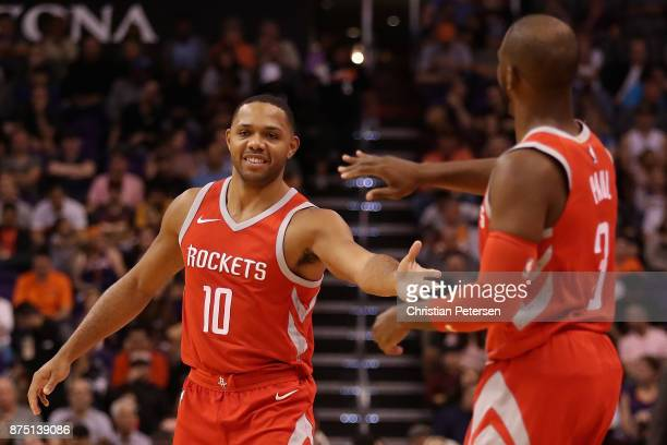 Eric Gordon of the Houston Rockets high fives Chris Paul during the first half of the NBA game against the Phoenix Suns at Talking Stick Resort Arena...