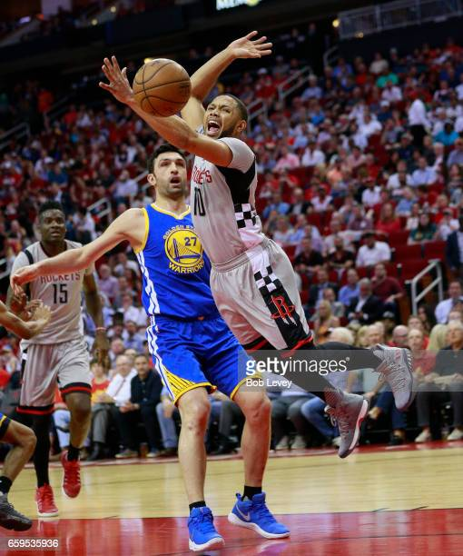 Eric Gordon of the Houston Rockets is fouled by Zaza Pachulia of the Golden State Warriors during the first quarter at Toyota Center on March 28 2017...