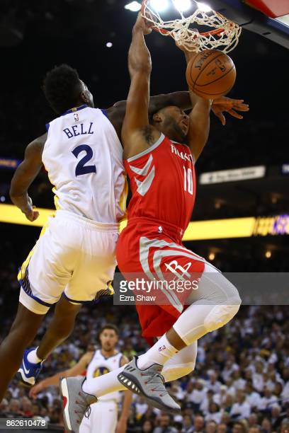 Eric Gordon of the Houston Rockets is hit after a dunk by Jordan Bell of the Golden State Warriors during their NBA game at ORACLE Arena on October...