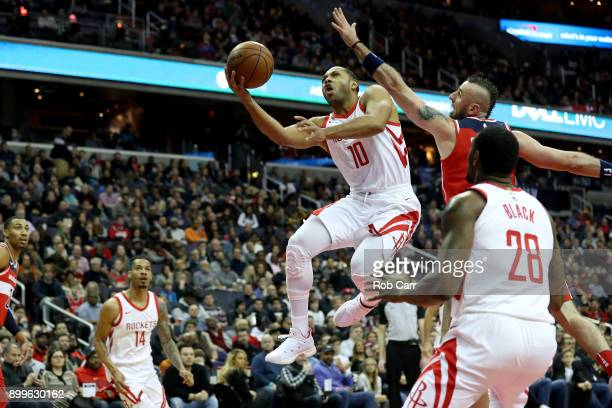 Eric Gordon of the Houston Rockets puts up a shot in front of Marcin Gortat of the Washington Wizards in the first half at Capital One Arena on...