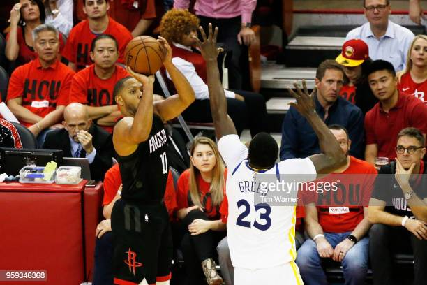 Eric Gordon of the Houston Rockets shoots against Draymond Green of the Golden State Warriors in the fourth quarter of Game Two of the Western...