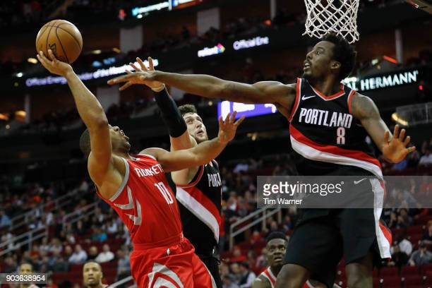 Eric Gordon of the Houston Rockets shoots the ball defended by AlFarouq Aminu of the Portland Trail Blazers and Jusuf Nurkic in the second half at...