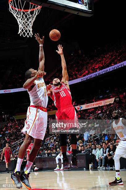 Eric Gordon of the Houston Rockets shoots the ball over Dwight Howard of the Atlanta Hawks during a game on November 5 2016 at Philips Arena in...
