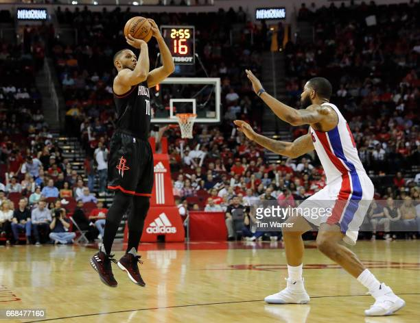 Eric Gordon of the Houston Rockets takes a three point shot defended by Marcus Morris of the Detroit Pistons in the first half at Toyota Center on...