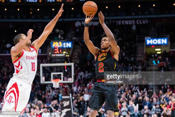 Eric Gordon of the Houston Rockets tries to block Collin Sexton of the Cleveland Cavaliers during the second half at Quicken Loans Arena on November...