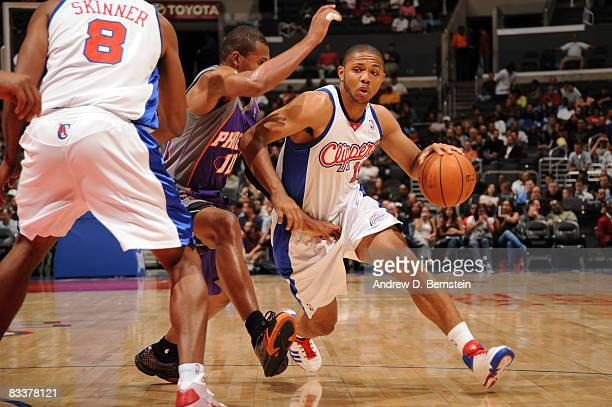 Eric Gordon of the Los Angeles Clippers dribbles the ball against Leandro Barbosa of the Phoenix Suns att Staples Center on October 21 2008 in Los...