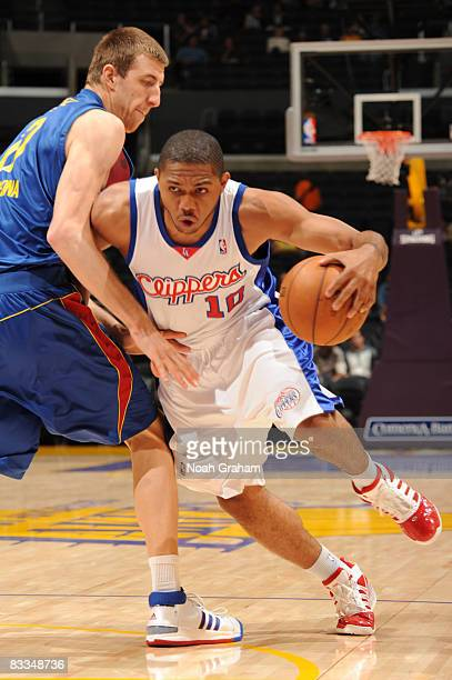 Eric Gordon of the Los Angeles Clippers drives past Fran Vazquez of Regal FC Barcelona during their game at Staples Center on October 19 2008 in Los...