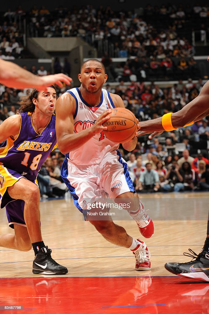 Eric Gordon #10 of the Los Angeles Clippers drives the lane past Sasha Vujacic #18 of the Los Angeles Lakers at Staples Center on October 29, 2008 in Los Angeles, California.