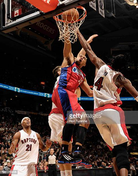 Eric Gordon of the Los Angeles Clippers goes in for the dunk defended by Chris Bosh of the Toronto Raptors during a game on March 31 2010 at the Air...