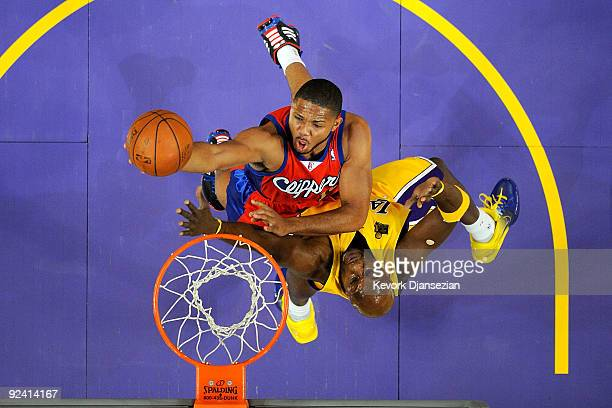 Eric Gordon of the Los Angeles Clippers goes to the basket against Lamar Odom of the Los Angeles Lakers during the season opening game at Staples...