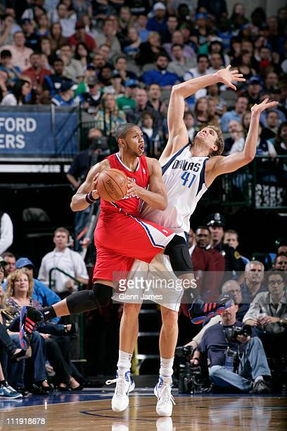 Eric Gordon of the Los Angeles Clippers looks to pass against Dirk Nowitzki of the Dallas Mavericks during the game on April 8 2011 at the American...