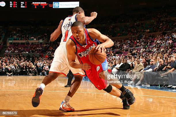 Eric Gordon of the Los Angeles Clippers makes a move to the basket around Chris Duhon of the New York Knicks during the game at Madison Square Garden...