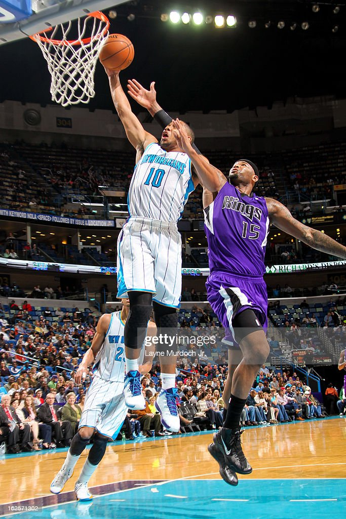 Eric Gordon #10 of the New Orleans Hornets drives to the basket against DeMarcus Cousins #15 of the Sacramento Kings on February 24, 2013 at the New Orleans Arena in New Orleans, Louisiana.