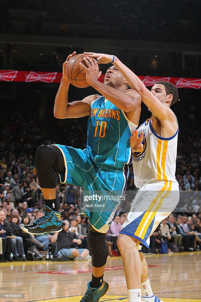 Eric Gordon #10 of the New Orleans Hornets drives to the basket against the Golden State Warriors on April 3, 2013 at Oracle Arena in Oakland, California.