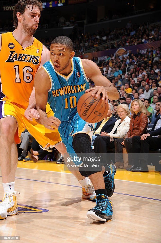 Eric Gordon #10 of the New Orleans Hornets drives to the basket against Pau Gasol #16 of the Los Angeles Lakers at Staples Center on April 9, 2013 in Los Angeles, California.