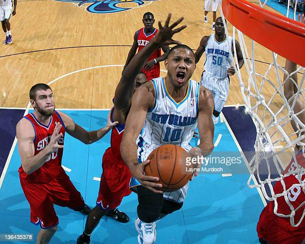 Eric Gordon of the New Orleans Hornets goes to the basket under pressure during an NBA game between the Philadelphia 76ers and the New Orleans...