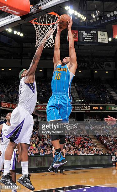 Eric Gordon of the New Orleans Hornets goes up for the dunk against DeMarcus Cousins of the Sacramento Kings on April 10 2013 at Sleep Train Arena in...